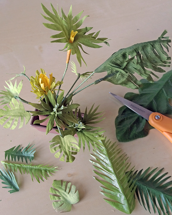 experimenting with palm leaf shapes cut from fabric flower foliage