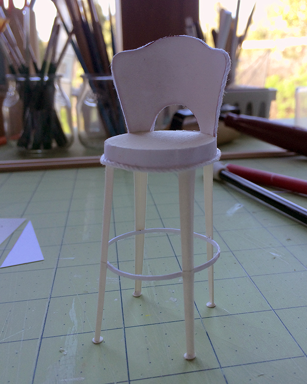 Metal stool (unpainted) made from cardstock, wood and string from a tutorial by Kris Kompas